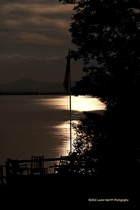The flag in the moonlight over Lake Champlain