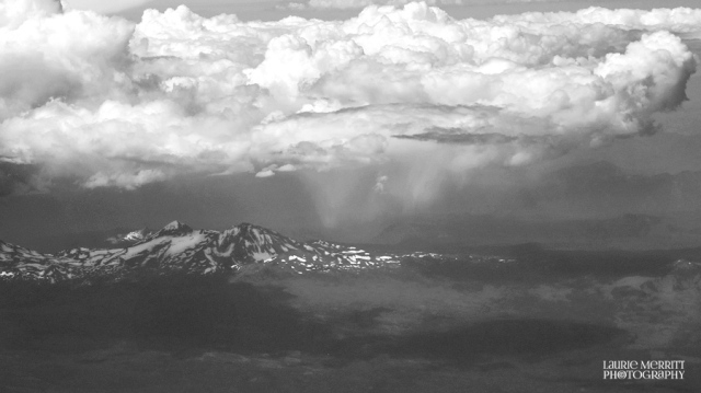 Rain showers over what could be (in looking at flight route) Lassen Volcanic National Park